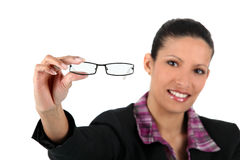 Woman holding her glasses far Royalty Free Stock Photo