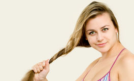 Woman holding her hair Royalty Free Stock Image