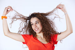 Woman holding her hair in the air Stock Photos