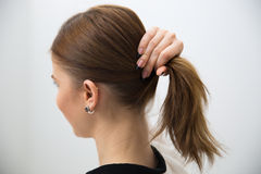 Woman holding her hair. Side view portrait of a woman holding her hair Stock Images