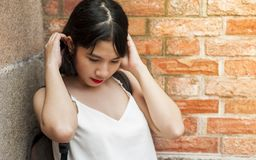 Woman Holding Her Hair While Standing on the Corner Stock Photos