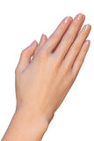 Woman is holding her hands for prayer. A closeup of a female hands that are touching each other very gently. A woman is holding a palm of her hand next to Royalty Free Stock Images