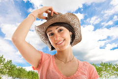 Woman holding her hat Royalty Free Stock Image