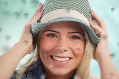 Woman holding her hat Royalty Free Stock Photo