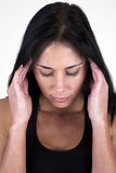Woman holding her head in her hands. Headache royalty free stock image
