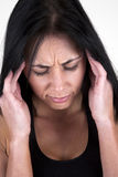 Woman holding her head in her hands. Headache Stock Photo