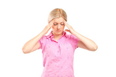 Woman holding her head in pain. A woman holding her head in pain as a result of a headache isolated on white background Stock Photo