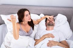 Free Woman Holding Her Husband& 039;s Nose To Stop Him From Snoring Stock Image - 181289521