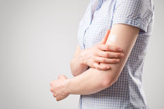 Woman Holding Her Injured Arm Stock Image