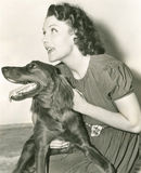 A woman holding her Irish setter Royalty Free Stock Photography