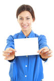 Woman holding her large blank visiting card with both hands Royalty Free Stock Photo