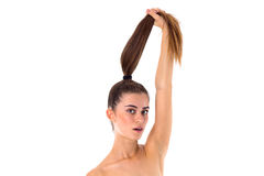 Woman holding her long ponytail Stock Photography