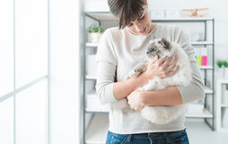 Woman holding her lovely cat Stock Image