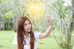 Woman holding her mobile phone and taking selfie Royalty Free Stock Photo