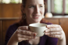 Woman Holding Her Morning Cup of Coffee Stock Images