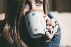 Woman Holding Her Multicolored Polka-dot Ceramic Mug Royalty Free Stock Photo