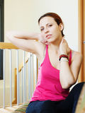 Woman holding her neck because ill. At home Royalty Free Stock Image