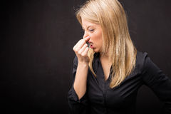Woman holding her nose Royalty Free Stock Photo