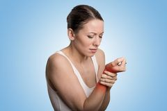 Woman holding her painful wrist Royalty Free Stock Photo