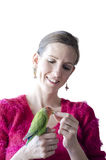 Woman holding her parrot Royalty Free Stock Photos