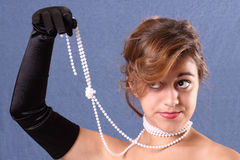 Woman holding her pearls Stock Photo