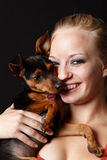 Woman holding her puppy Stock Photos
