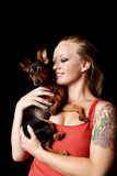 Woman holding her puppy Royalty Free Stock Image