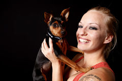 Woman holding her puppy Stock Image