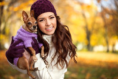 Woman holding her puppy after in the park royalty free stock images
