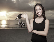 Woman holding her shoes Royalty Free Stock Images