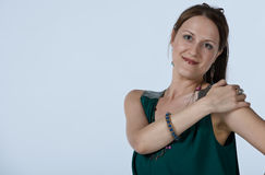 Woman holding her shoulder Royalty Free Stock Photography