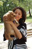 Woman holding her spaniel dog Royalty Free Stock Image