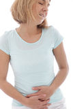 Woman holding her stomach in pain Stock Image