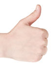 Woman holding her thumb up. Closeup of a woman holding her thumb up over an white background Royalty Free Stock Photo