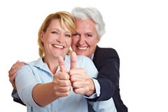 Woman holding her thumbs up Royalty Free Stock Images