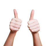 Woman holding her thumbs up Stock Images