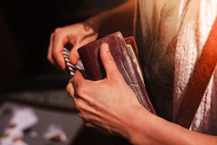 Woman holding her wallet outdoors Stock Photos
