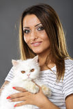 Woman holding her white cat Royalty Free Stock Image