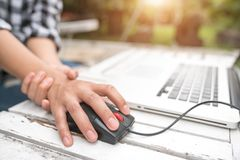 Woman holding her wrist pain from using computer. Office syndrome.  royalty free stock photography