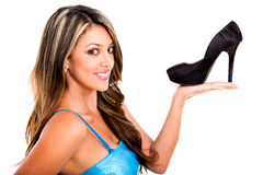 Woman holding a high-heel Stock Image