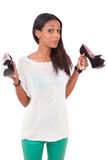 Woman holding a high heel shoe in her hands Royalty Free Stock Images