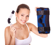 Woman holding hinged knee braces. stock photo