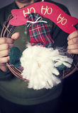 Woman holding ho ho ho sign. With Santa Royalty Free Stock Photo