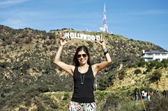 Woman holding the Hollywood Sign Stock Photo
