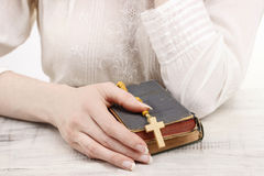 Woman holding Holy Bible and wooden rosary Royalty Free Stock Images