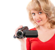Woman holding a home video camera. Close-up of a woman holding a home video camera Royalty Free Stock Photography
