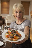 Woman Holding Hors D'oeuvres On Plate Stock Images