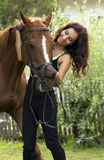 Woman holding horse Royalty Free Stock Photography