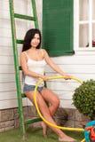 Woman holding a hose Stock Photos