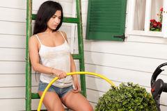 Woman holding a hose Royalty Free Stock Photo